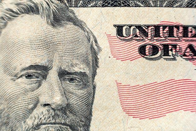 Деньги красочный фон крупным планом. детали счетов банкнот американской национальной валюты. символ богатства и процветания. концепция денежных средств, занятости и финансов.