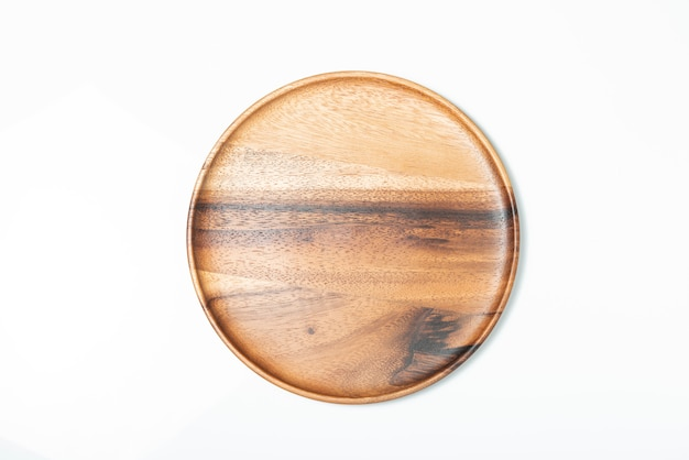 Опорожните деревянную плиту изолированную на белизне, взгляд сверху.