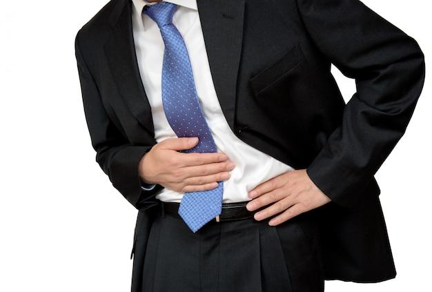 腹痛に苦しんでいる実業家。