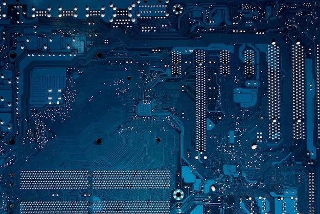 コンピューターのマザーボードの青い回路基板の背景。