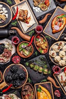 Грузинский большой накрытый стол разных блюд