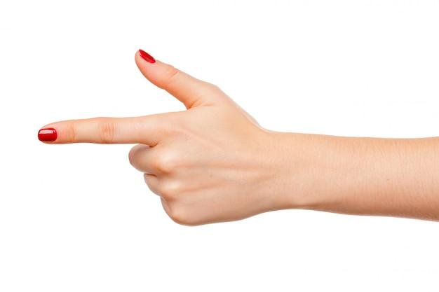 女性の手は白で隔離される何かで指を指す
