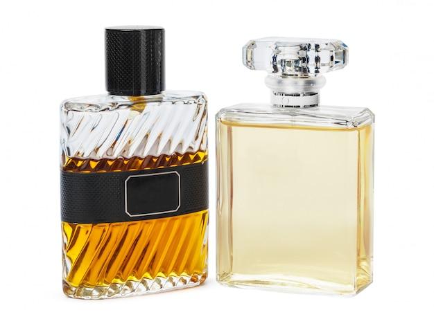 白い背景に対して隔離される香水瓶