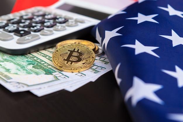 アメリカの国旗とビットコイン、インターネット上の新しい経済