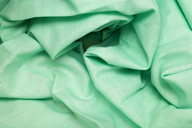 抽象的な背景として緑の布