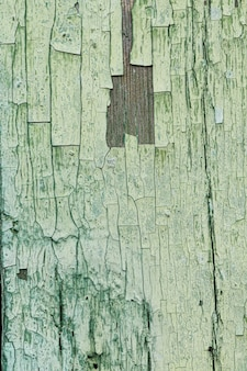 古い傷の緑の木製の背景
