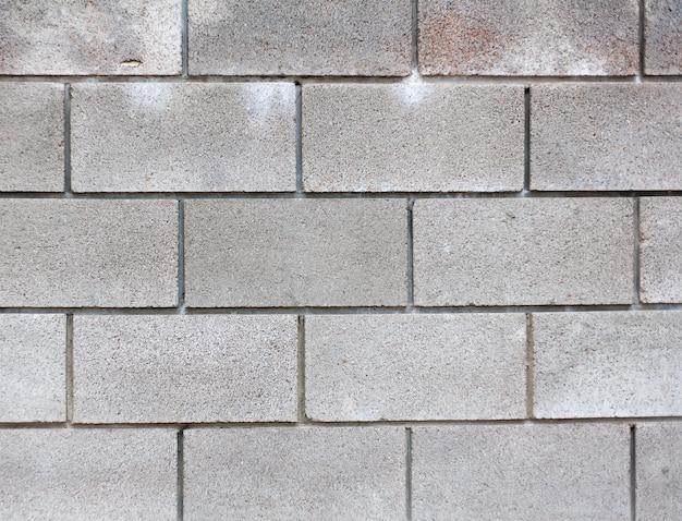 背景テクスチャのモダンな灰色のレンガの壁