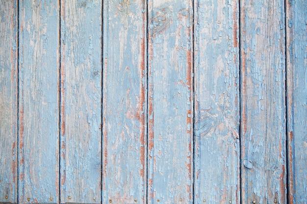 古い青い木製のフェンス、背景のテクスチャ