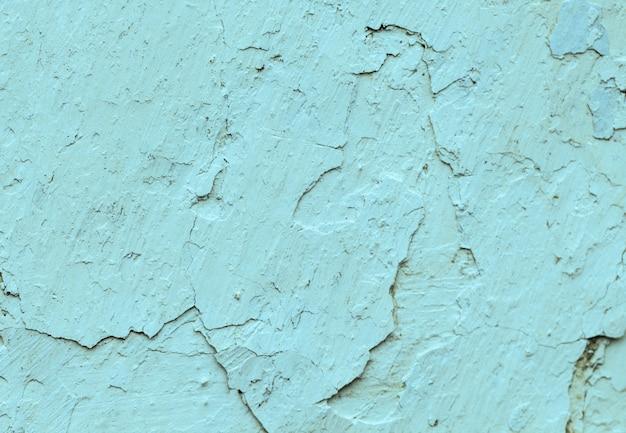 Старые бетонные синие стены с трещинами краски, заготовка для дизайна,