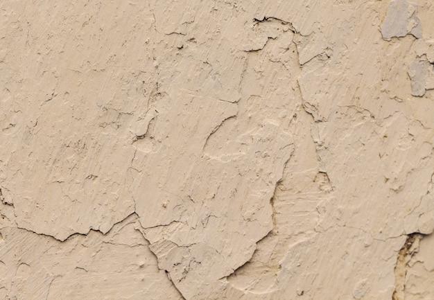 Старые бетонные серые стены с трещинами краски, заготовка для дизайна,