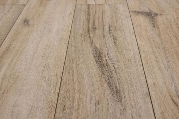 シームレスなオークラミネート寄木細工の床のテクスチャ背景