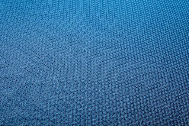 青いフェルトテクスチャ抽象芸術の背景。コーデュロイのテキスタイルパターンの表面。背景、壁紙として使用できます
