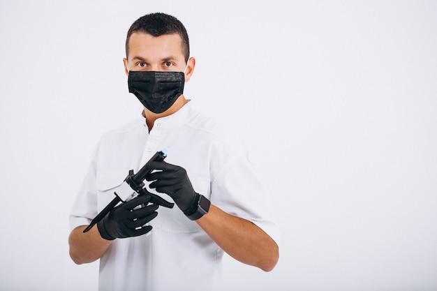 歯医者の服を着て