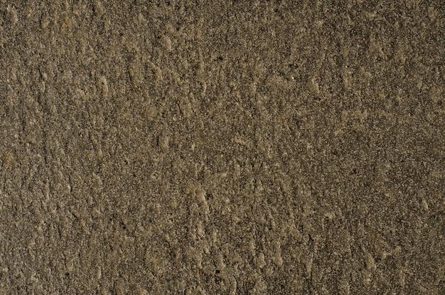 茶色のコンクリート汚れた壁のテクスチャの背景