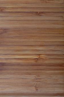 素朴な竹のテクスチャ。水平線。黄土色と茶色のトーン。