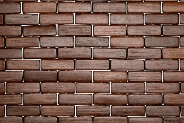 レンガ(天然繊維と植物繊維の集合)のような小さな長方形の形をしたダークウッドテクスチャ。