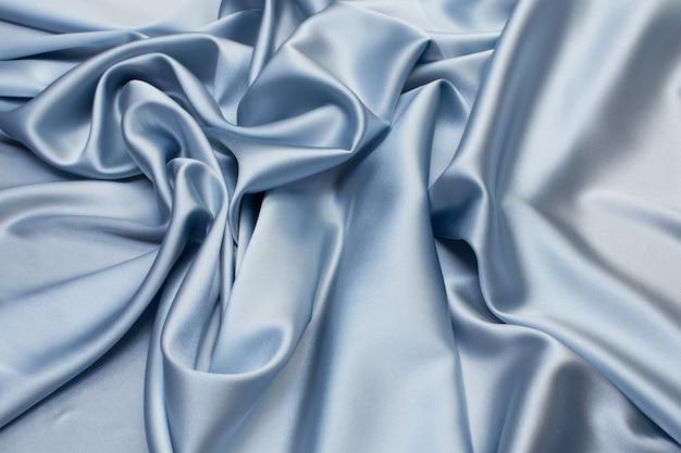 Шелковая ткань, сатин. цвет синий. текстура,