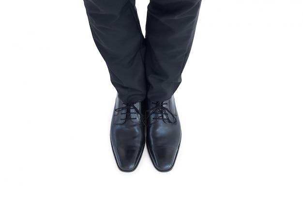 Ноги бизнесменов в черных бродах
