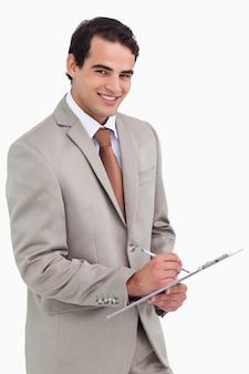 メモ帳とペンで笑顔セールスマン