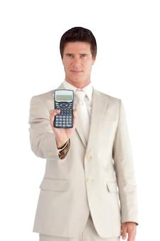 深刻なビジネスマンは、電卓を表示