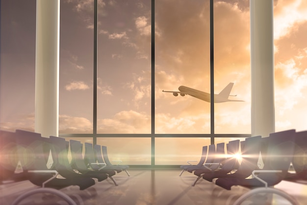 出発ラウンジラウンジの窓を飛行する飛行機