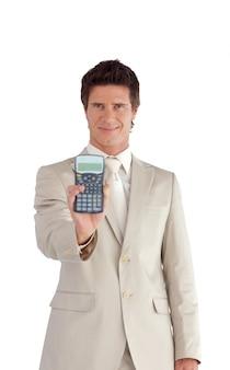 ビジネスマン、彼の手に電卓を持って