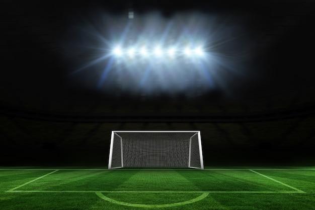 サッカーのピッチとスポットライトの下のゴール