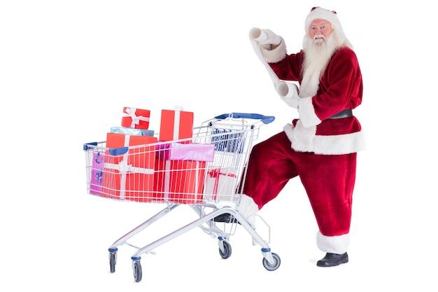 サンタは読書中にショッピングカートをプッシュする