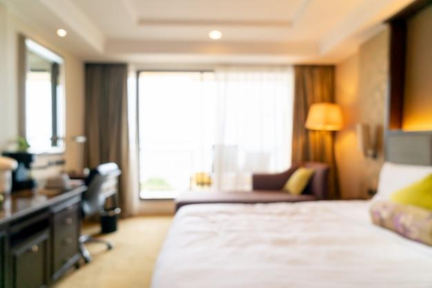 抽象的なぼかしホテルの寝室のインテリア