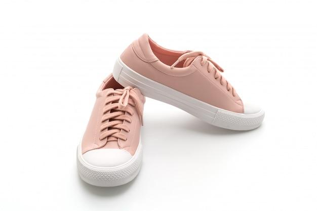 Пара розовых кроссовок