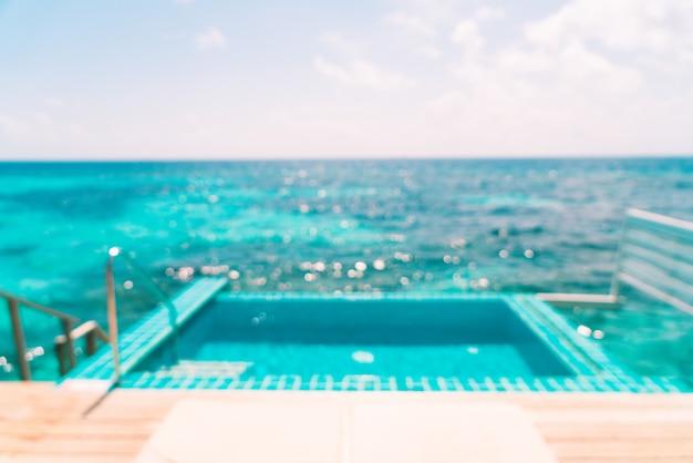 抽象的なぼかしモルディブのプールと海の背景