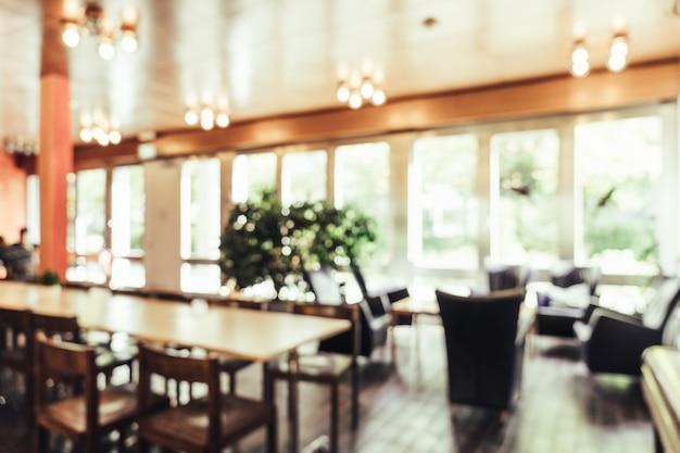 背景のレストランで抽象的なぼかし