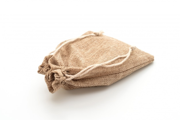 Мешочек из ткани на белой поверхности