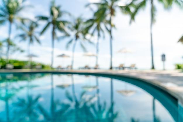 Абстрактный размытия кровать бассейн вокруг бассейна в роскошном отеле курорта