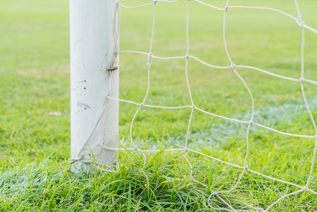 サッカーゴールサッカーグリーングラスフィールド