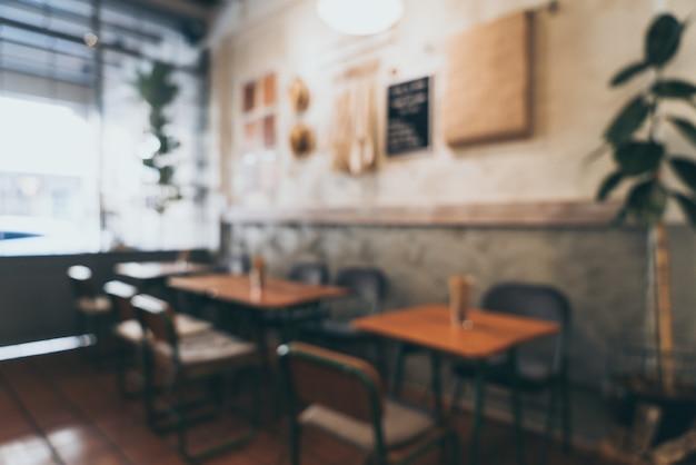 抽象的なぼかしとコーヒーショップと背景のカフェでピンぼけ