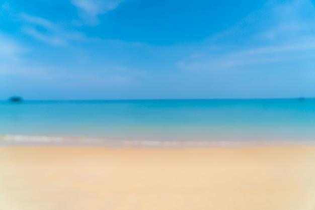 抽象的なぼかしと美しい熱帯のビーチとパラダイス島の海のぼかし