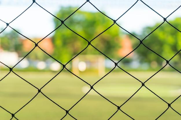 サッカーフィールドの背景とクローズアップネット