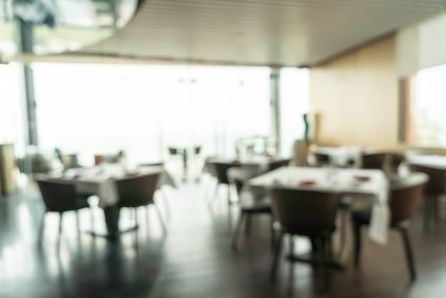 Абстрактный размытый и расфокусированный завтрак в интерьере ресторана отеля