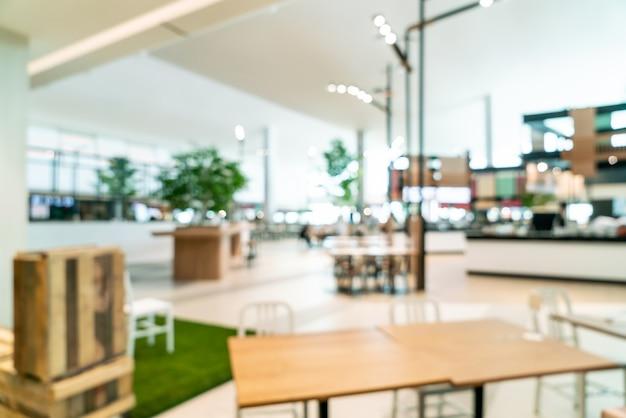 ショッピングモールの抽象的なぼかしと多重フードコートセンター
