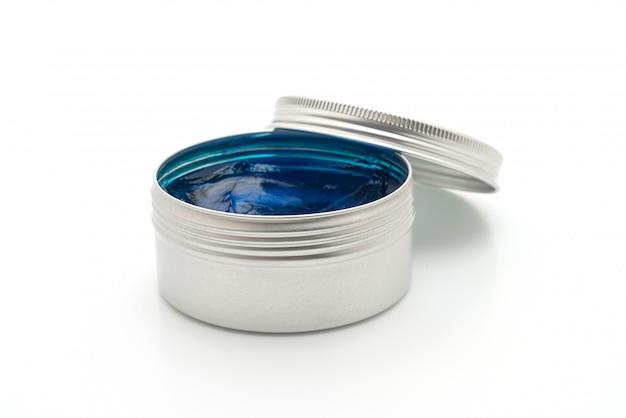 Помада для укладки волос в воде на белом фоне
