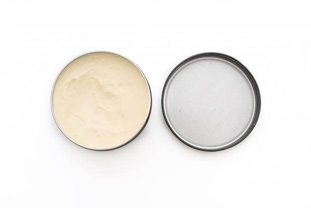 Помада для укладки волос в масле на белом фоне