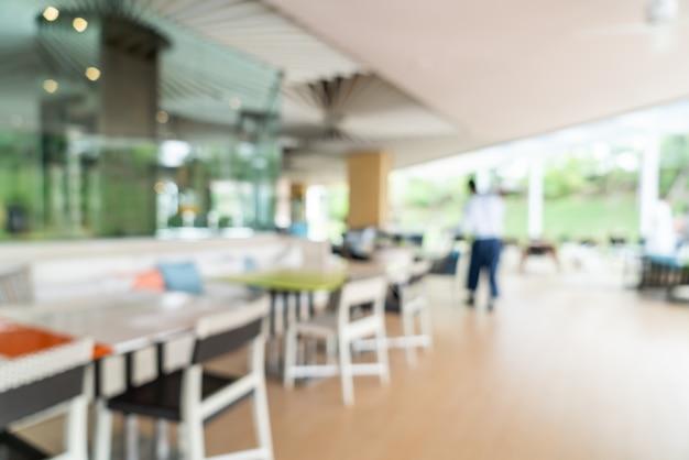 ホテルのレストランのインテリアで抽象的なぼかしと多重の朝食ビュッフェ