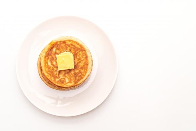 背景がバターのパンケーキ