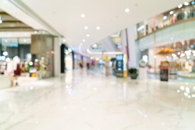 抽象的なぼかしと多重の高級ショッピングモール