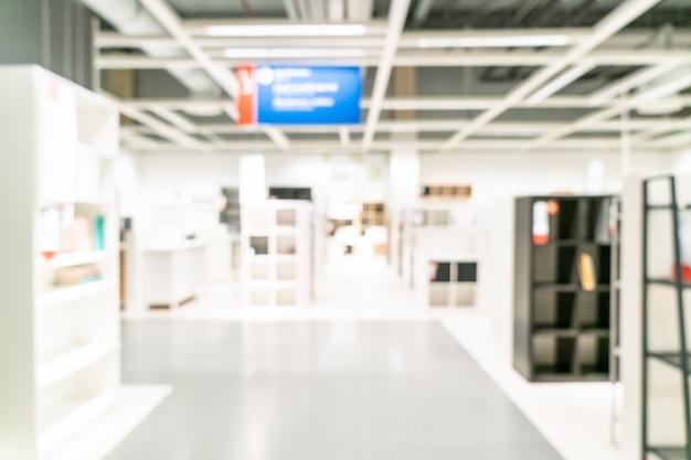 Абстрактное размытие мебели, декорации и складского интерьера магазина