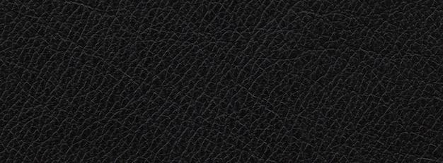 Крупным планом, макро выстрел из натуральной черной кожи текстуры фона