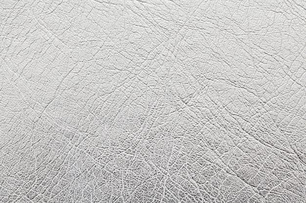 Крупным планом выстрел из серебряной кожи текстуры фона