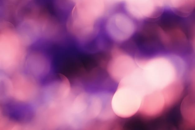 ボケ味を持つ抽象的な背景デフォーカスライトと影。多色ボケ。ビンテージスタイル。ディスコライト。