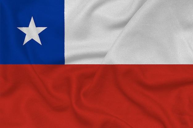 工場のニット生地からチリの旗